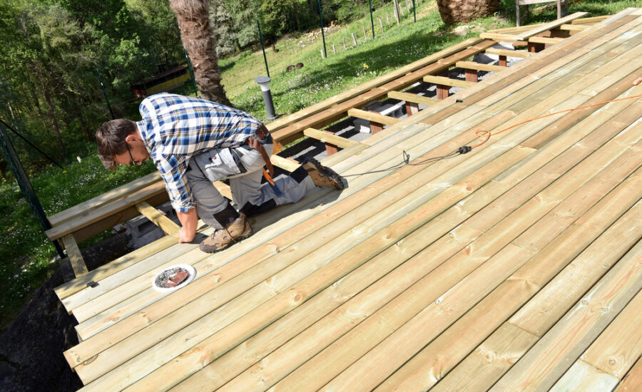 deck repairs being done by skilled carpenter at Pink Hammer Home