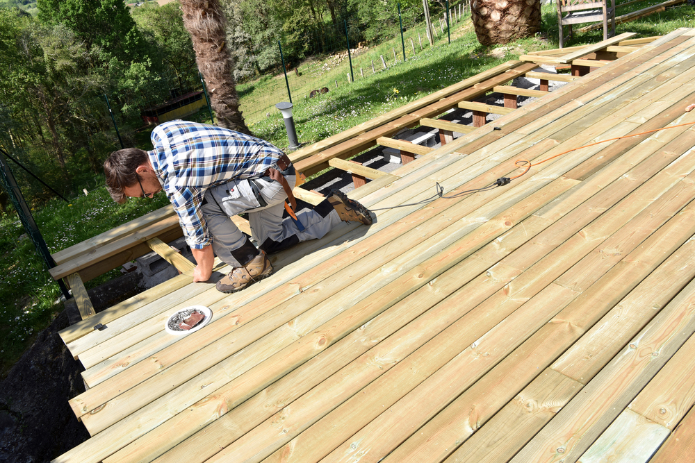 Contractor performing deck repair service